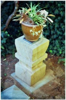 Hand carved stone garden plinth
