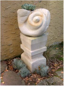Classic Shell Design carved in stone on plinth